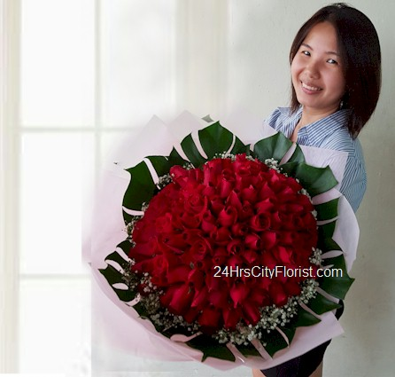 Chris with her 99 red rose bouquet