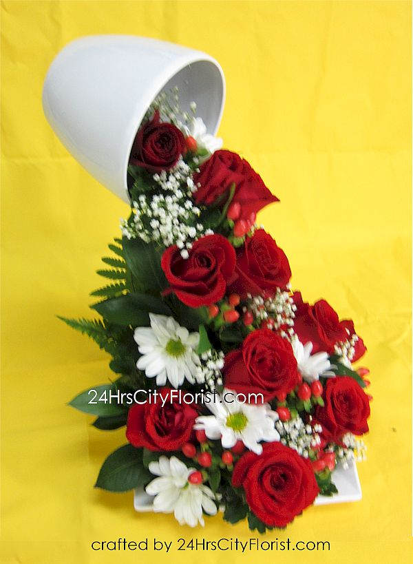 flying or floating cup fresh flower arrangement