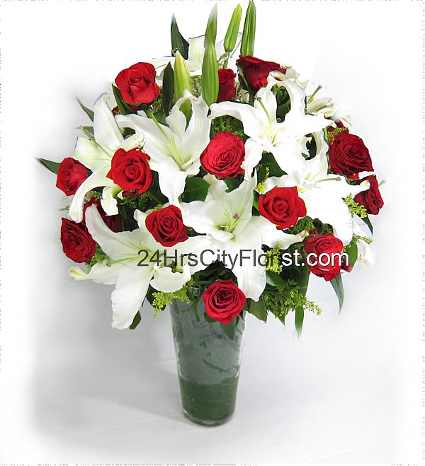 White lily and red rose vase arrangement
