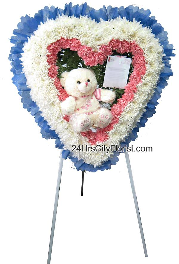 heart shaped wreath with plush bear