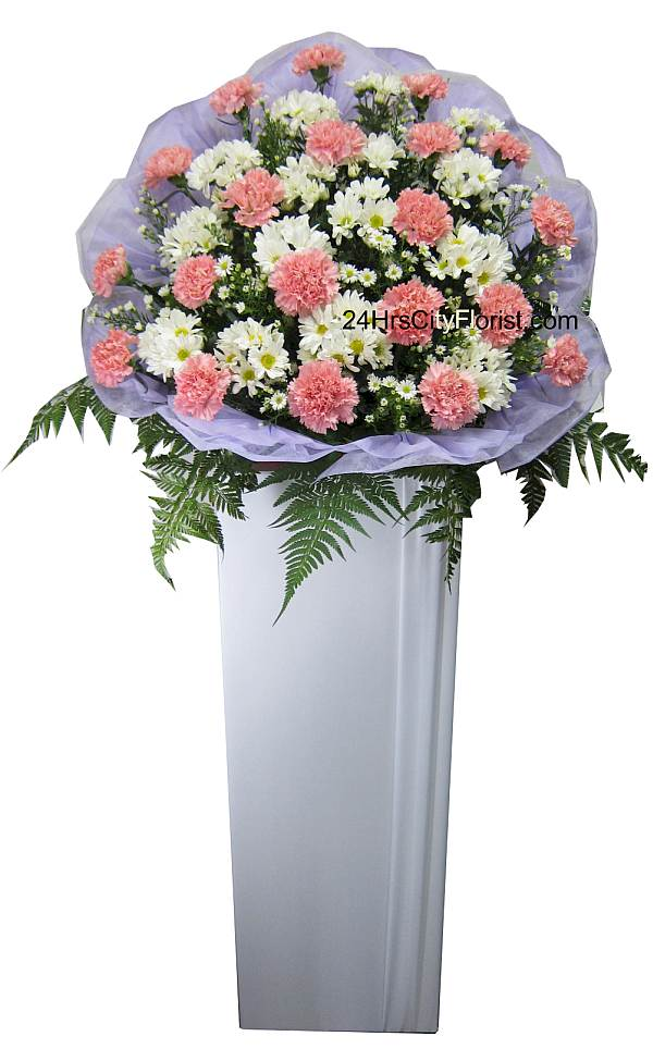condolence flower stands with pink carnations flowers