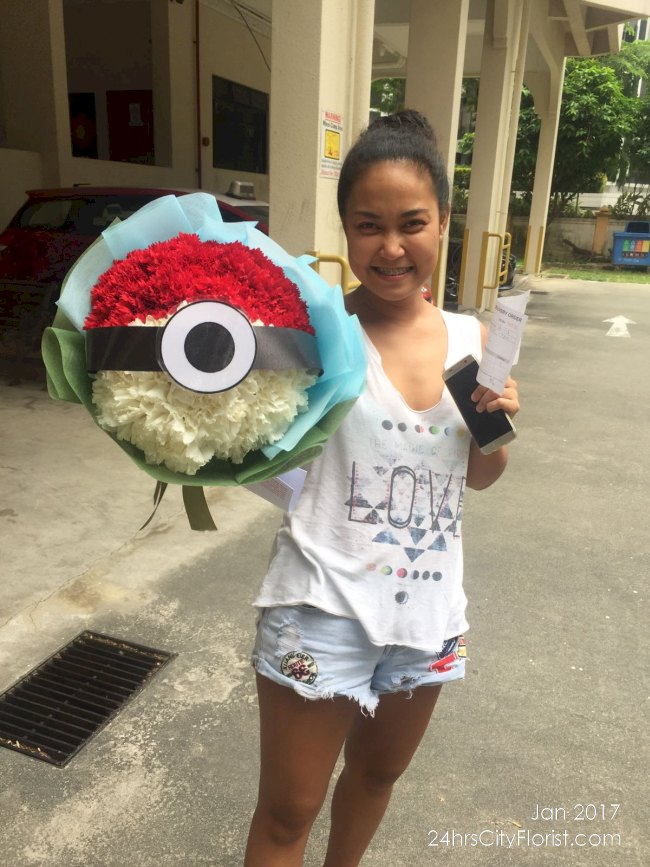Isabel with her pokeball bouquet