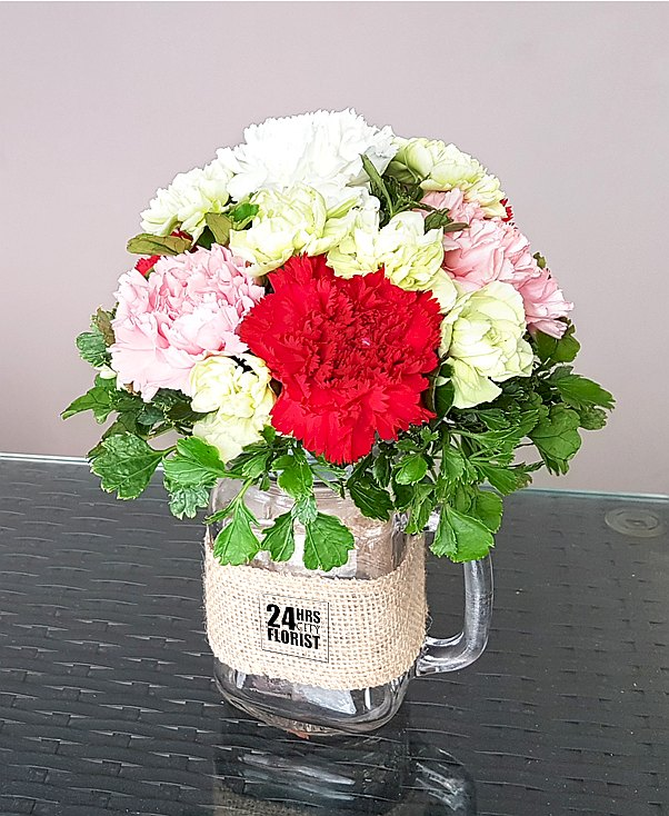 carnations arranged in mason jar