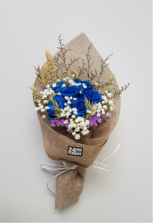 blue rose bouquet with rustic wrapping
