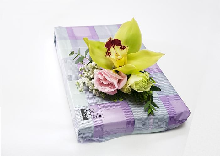 fresh flowers wrapped on a gift