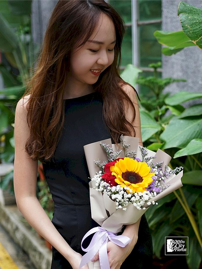 sunflower with  red roses bouquet