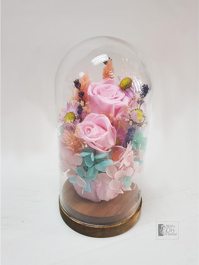dried flowers in glass dome