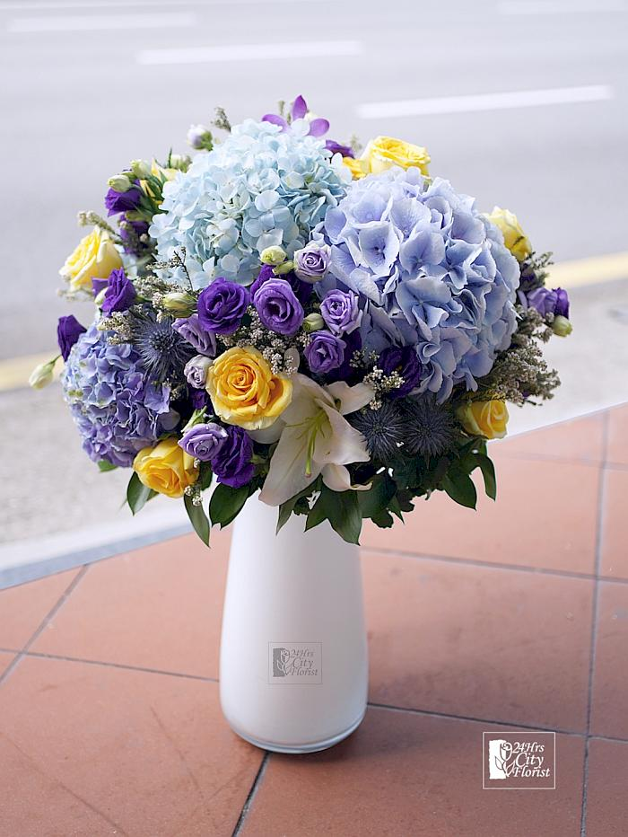 flower arrangement on pedestal
