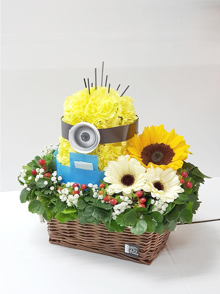 Bello Minion Arranged With Flowers In A Basket